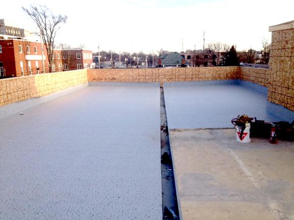 Installation of Duradek vinyl membrane on roof deck.