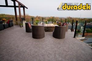 Duradek Macchiato vinyl membrane and Durarail Panorama Post topless glass railing system.