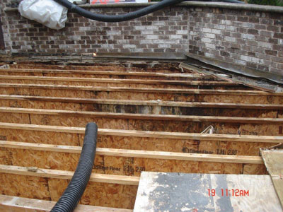 Deck joists remaining after rotted wood was removed from failed tile deck