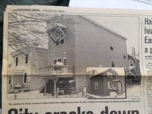 A newspaper clipping from 2002 shows the deck of the house was part of a controversial addition to the original home. (Daily News clipping)
