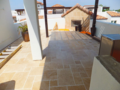 The new tiles are beautiful, but more importantly, underneath them is a reliable, roof-grade waterproofing membrane.