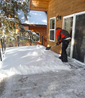 Shoveling snow off a Duradek deck.