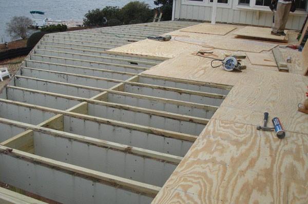 Preparing substrate for Duradek vinyl decking.