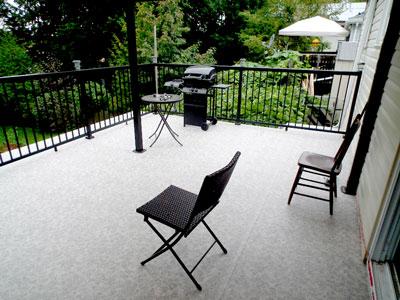 Duradek Forest Floor vinyl deck installed by Deck World North.