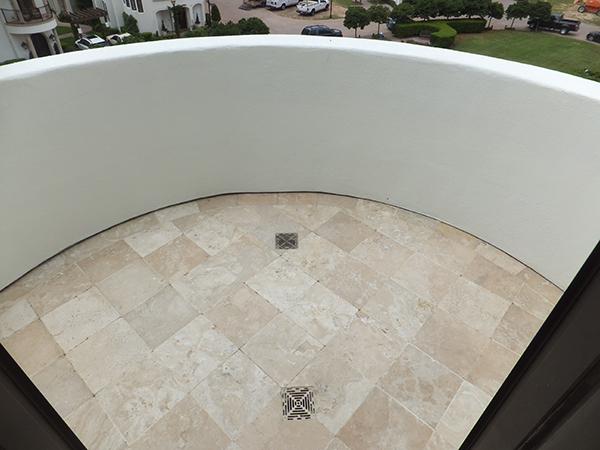 Balcony waterproofed with Tiledek nad proper water routing from Duradek installers.