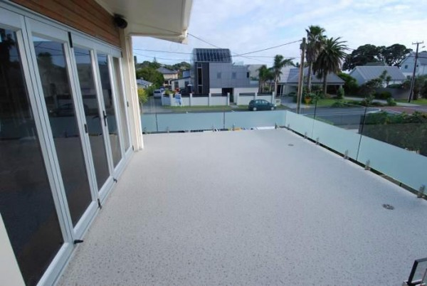 Duradek Supreme Chip Granite Deck at Red Beach.