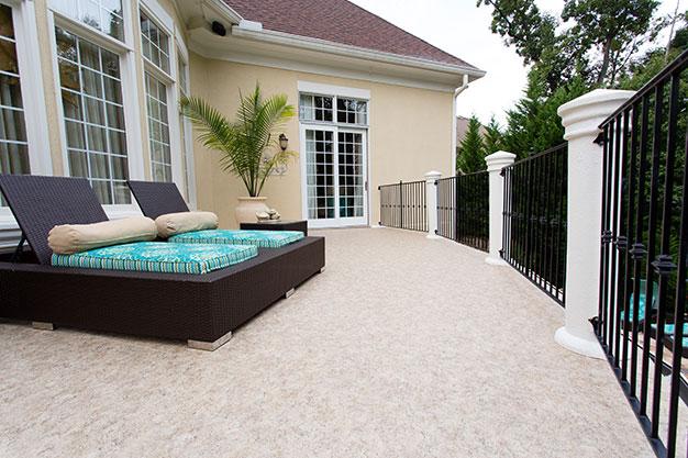 Second level vinyl deck for leisurely luxury.