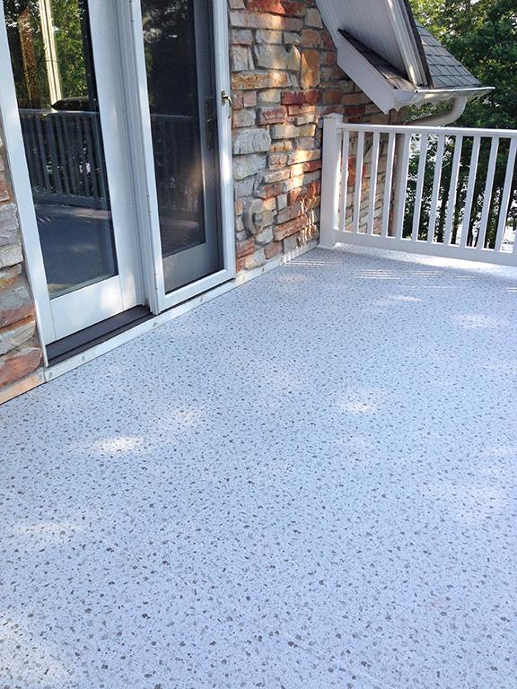 Deck waterproofed with Duadek vinyl deck membrane.