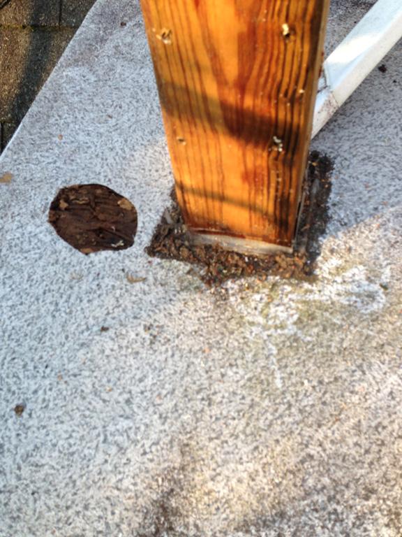 improper waterproofing around a deck post