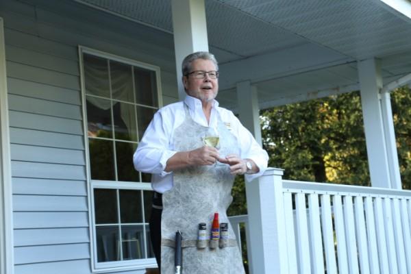Trevor Daniel makes his retirement speech wearing his commemorative Duradek vinyl barbecue apron </br><p id=