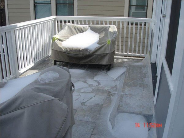 Tile deck that was not waterproofed and is protected with a plastic sheet.