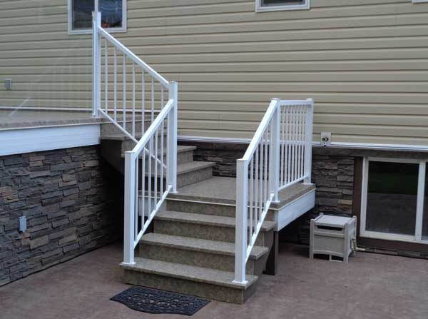 A staircase covered in slip resistant Duradek keeps the wood protected from the elements so the stairs stay safe and secure.